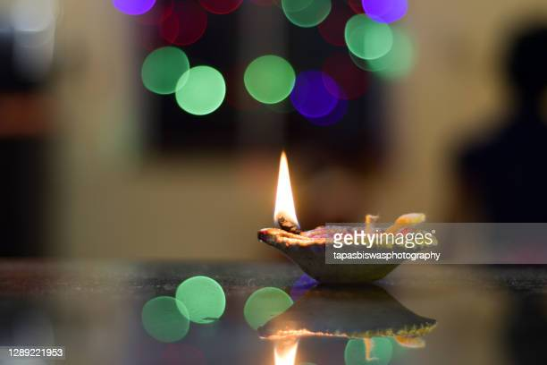 beautiful diwali lamp - candle stock pictures, royalty-free photos & images