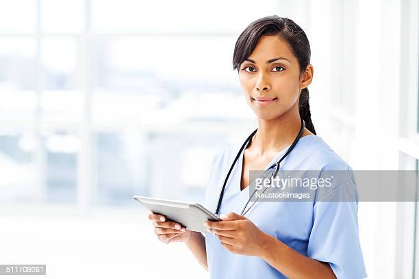 Beautiful Doctor Holding Digital Tablet In Hospital