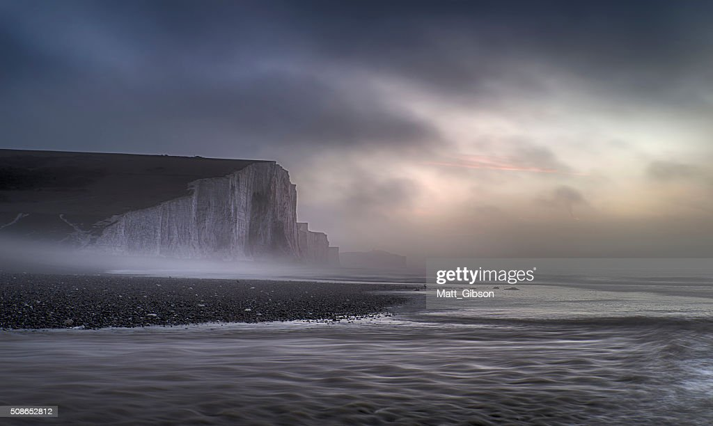 Beautiful dramatic foggy Winter sunrise Seven Sisters cliffs lan : Stock Photo