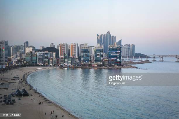 beautiful dusk view of busan city skyline along gwangalli beach with gwangan bridge, busan, south korea - busan stock pictures, royalty-free photos & images