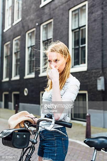 Beautiful Dutch blonde woman with bike