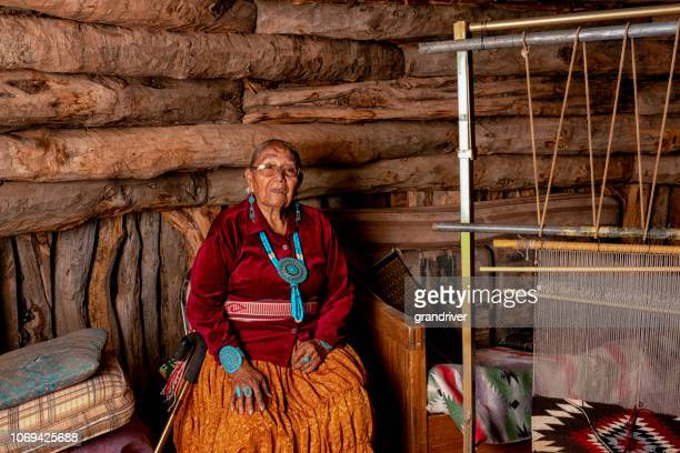 Beautiful Eighty Five Year Old Senior Native American Navajo Woman Posing Inside an Authentic Hogan