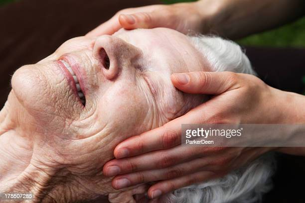 Beautiful Elderly Woman Receiving Gentle Massage
