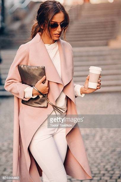 Beautiful elegant woman drinking coffee