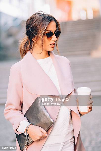beautiful elegant woman drinking coffee - ponytail stock pictures, royalty-free photos & images
