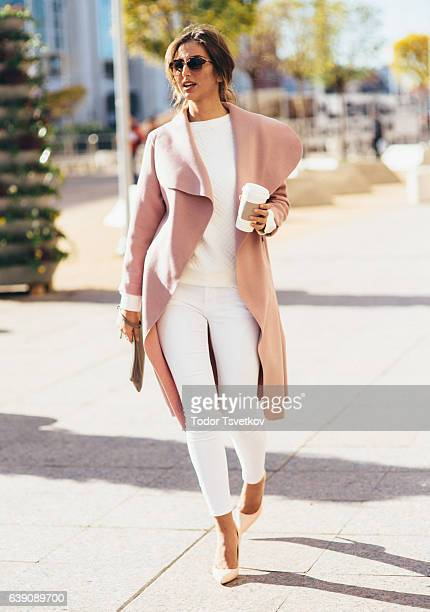 beautiful elegant woman drinking coffee - pink coat stock pictures, royalty-free photos & images