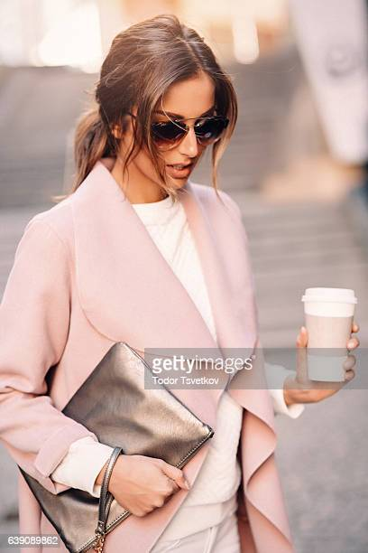 beautiful elegant woman drinking coffee - white purse stock pictures, royalty-free photos & images