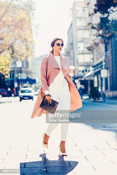 beautiful elegant woman drinking coffee - clutch bag stock pictures, royalty-free photos & images