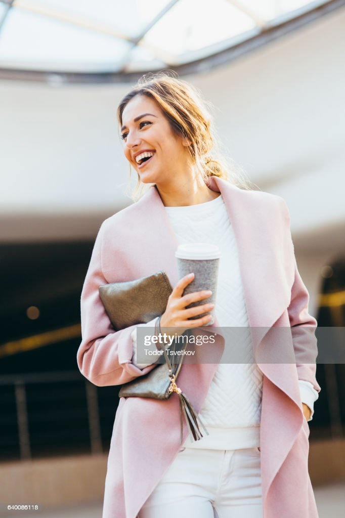 Beautiful elegant woman drinking coffee : Stock Photo