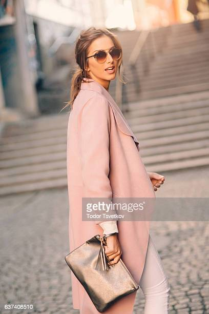 beautiful elegant woman - pink coat stock pictures, royalty-free photos & images