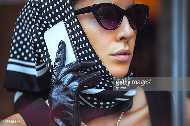 beautiful, elegant woman talking on the mobile phone - headscarf stock pictures, royalty-free photos & images