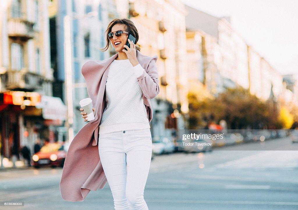 Beautiful elegant woman talking on the phone : Stock Photo