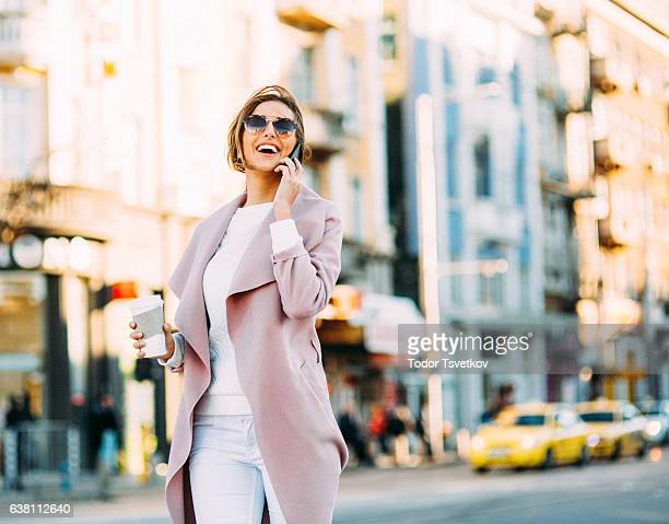 Beautiful elegant woman talking on the phone