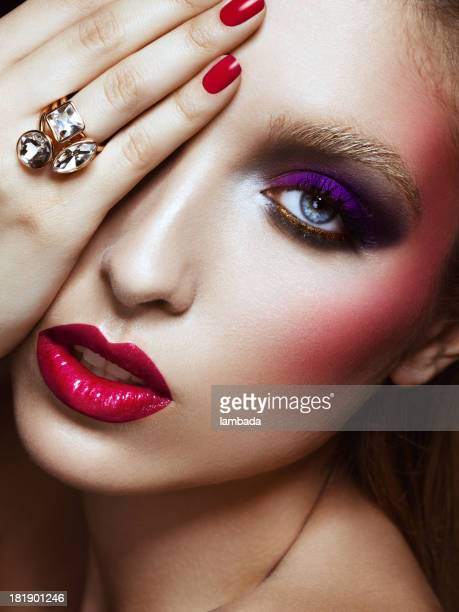 Beautiful elegant woman with bright make-up and ring