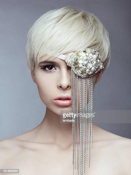 Beautiful elegant woman with eye mask