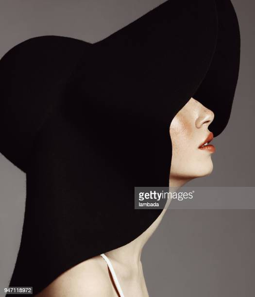 beautiful elegant woman with hat - fashion stock pictures, royalty-free photos & images