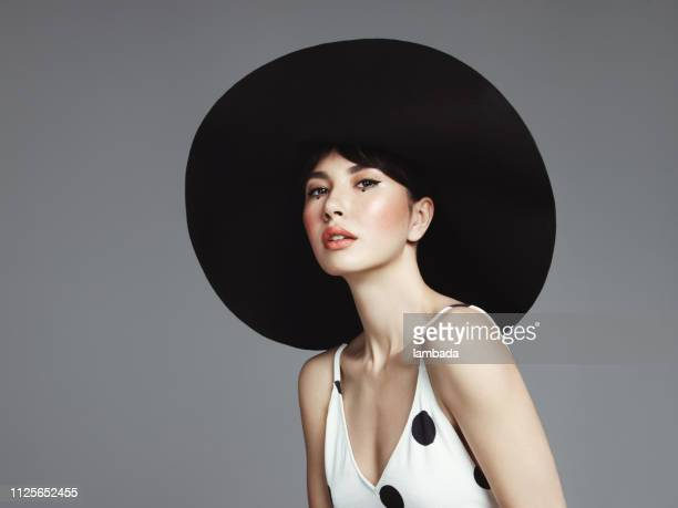 beautiful elegant woman with oversized hat - big beautiful black women stock photos and pictures