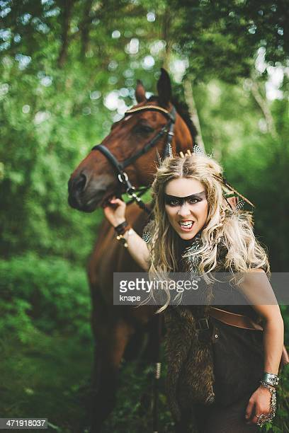 Beautiful elf warrior princess with her horse