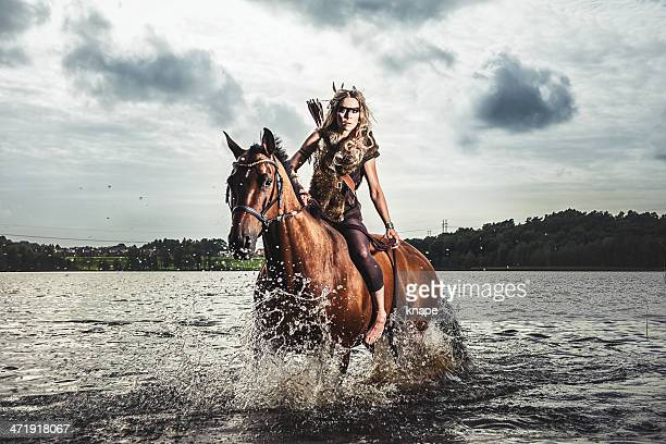 beautiful elf warrior princess with her horse - warrior person stock photos and pictures