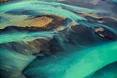 Beautiful emerald-colored glacial rivers of Iceland, taken from a helicopter