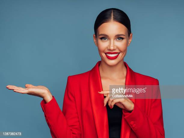 beautiful emotional woman presenting your product - blazer jacket stock pictures, royalty-free photos & images