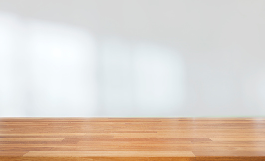 Beautiful empty wood table against abstract blur white interior background 1132790179