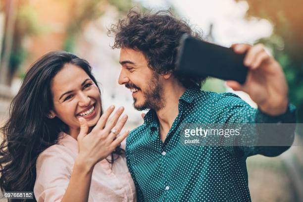 beautiful engaded couple making selfie - fiancé stock pictures, royalty-free photos & images