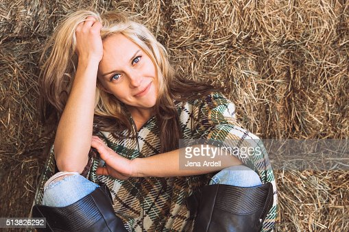 Beautiful Equestrian Woman Wearing Riding Boots And Plaid