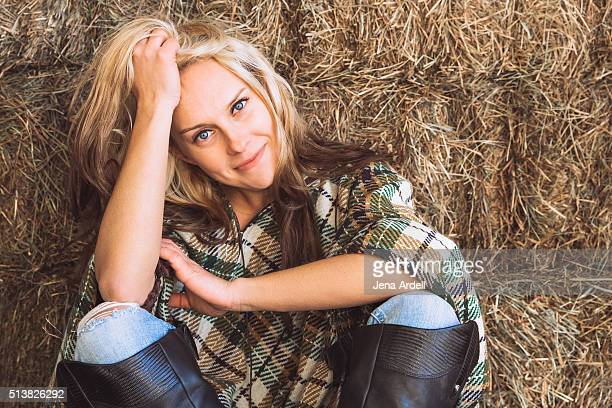 Beautiful Equestrian Woman Wearing Riding Boots And Plaid Poncho