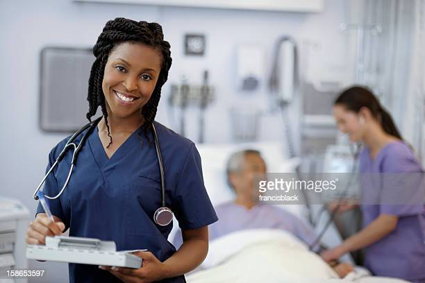 Beautiful ethnic female doctor examining a patient.