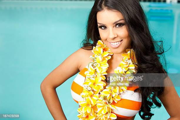 beautiful ethnic girl on vacation by pool - beautiful polynesian women stock photos and pictures
