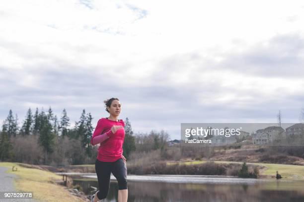 A Beautiful Eurasian Woman Goes Jogging Outside