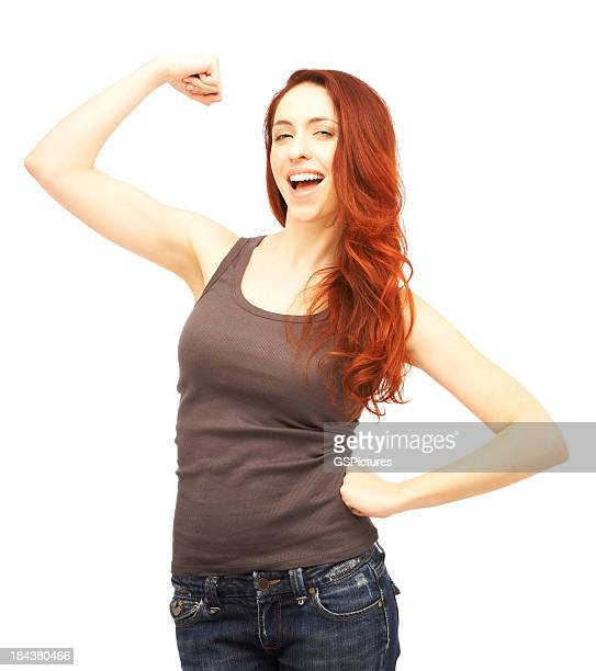 beautiful excited redhead woman flexing her muscles - dyed red hair stock pictures, royalty-free photos & images