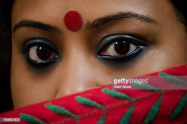 beautiful eyes of an indian woman behind sari - bindi stock pictures, royalty-free photos & images