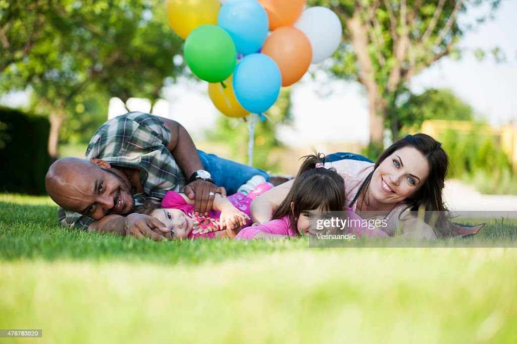 Beautiful family at picnic playing with balloons : Stock Photo