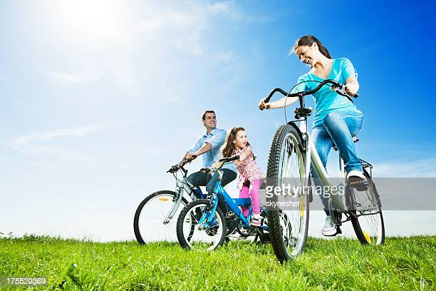 Beautiful family cycling in the park.