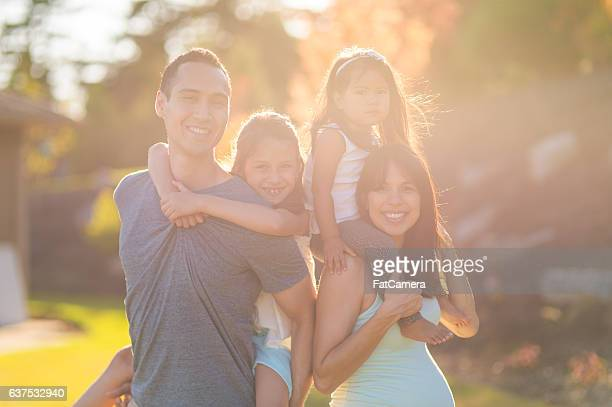 A beautiful ethnic family of four is spending time