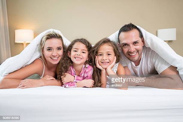 Beautiful family portrait in bed