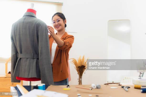 beautiful fashion designer standing in studio - customised stock pictures, royalty-free photos & images