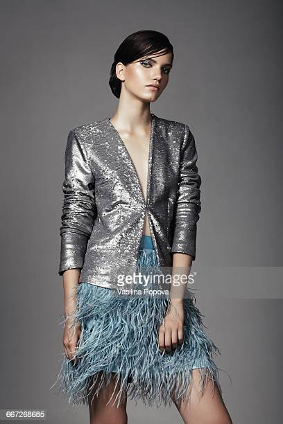 beautiful fashionable woman posing in studio - gray coat stock pictures, royalty-free photos & images