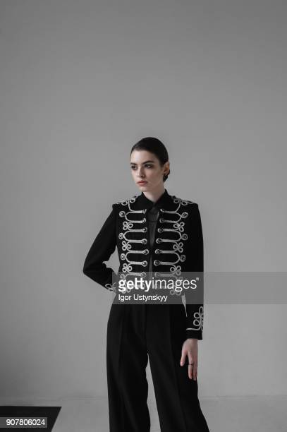 beautiful fashionable woman posing in studio - tomboy stock photos and pictures