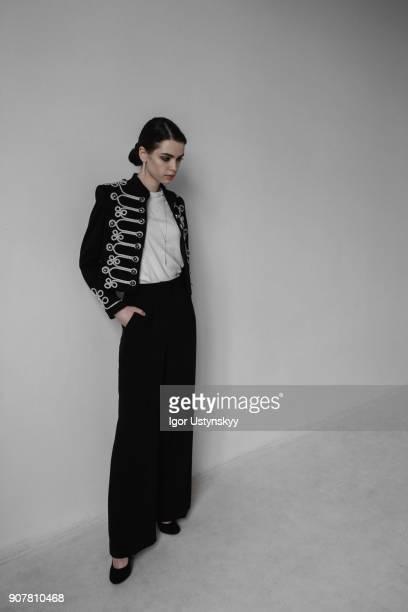 Beautiful fashionable woman posing in studio