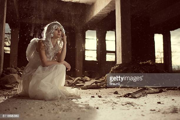 Beautiful female angel in an old ruin.