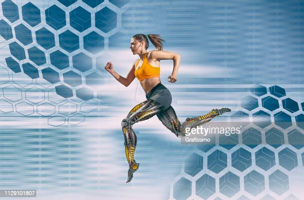 beautiful female athlete with artificial robotic legs running fast - draft sports stock pictures, royalty-free photos & images