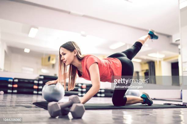 beautiful female athlete working out with fitness ball - beautiful bums stock pictures, royalty-free photos & images