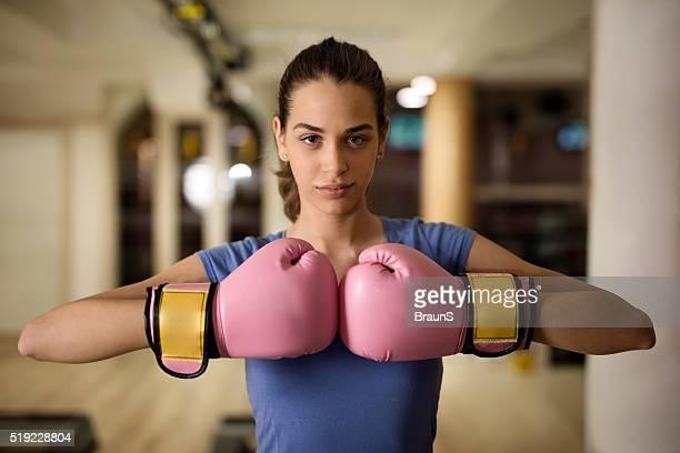 beautiful female boxer in a fighting stance at health club. - boxing gloves bildbanksfoton och bilder