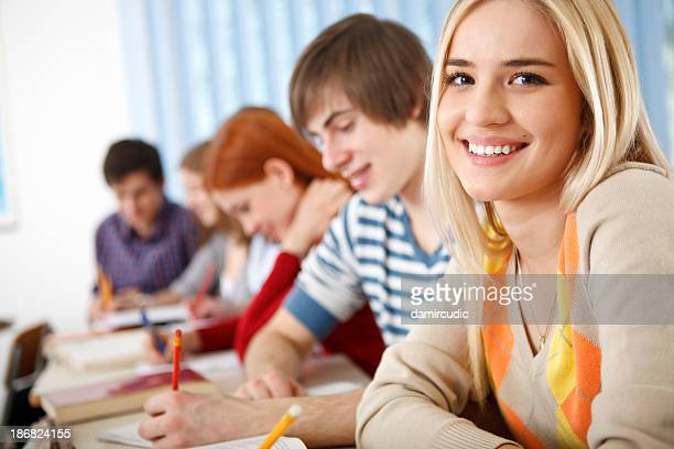 Beautiful female college student smiling in the classroom
