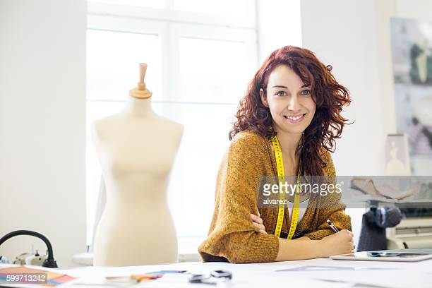 Beautiful female designer at design studio