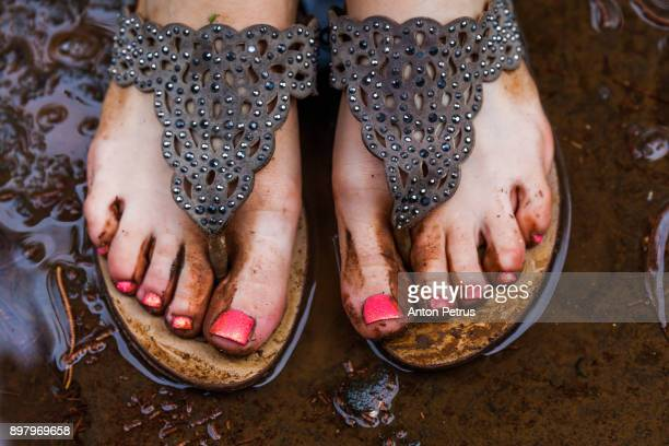 beautiful female feet in the mud after the rain - hot dirty girl stock photos and pictures