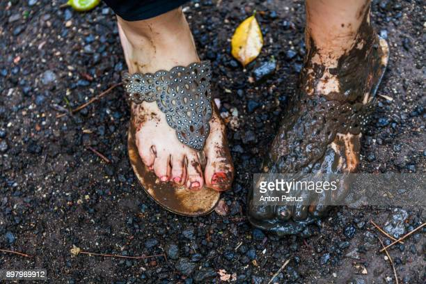beautiful female feet in the mud after the rain - dirty feet stock pictures, royalty-free photos & images